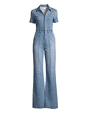 """Image of A flared leg is a feminine addition to this utilitarian denim jumpsuit. Spread collar Short sleeves Zip front Belt loops Side slash pockets Lined Cotton/elastane Machine wash Imported of Italian fabric SIZE & FIT Rise, about 16"""" Inseam, about 35"""" Leg open"""