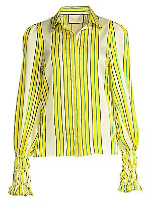 "Image of 70's inspired puff-sleeve blouse with bold vertical stripes and smocked, elongated ruffle-trimmed cuffs. Point collar Long puff sleeves Concealed button front placket Smocked cuffs Polyester Dry clean Imported SIZE & FIT Regular fit About 23.5"" from shoul"