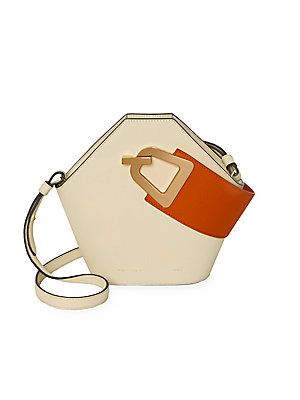 """Image of Modern geometric leather bucket bag with a contrasting top handle design. Top handle Magnetic popper clasp Goldtone hardware Cotton lining Leather Imported SIZE Adjustable, removable shoulder strap, 18"""" to 20"""" drop 10.5""""W x 8.5""""H x 4.5""""D. Handbags - Colle"""
