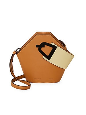 "Image of Modern geometric leather bucket bag with a contrasting top handle design. Top handle Magnetic popper clasp Cotton lining Leather Imported SIZE Adjustable, removable shoulder strap, 18""-20"" drop 10.5""W x 8.5""H x 4.5""D. Handbags - Collection Handbags > Saks"