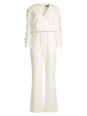 Image of A relaxed draped jumpsuit is trimmed with ruffles and delicate lattice-work detail down the arms. V-neck Long sleeves Concealed back zip Ruffle trim Latice trim Wrap front Fitted waist Lined Polyester/spandex Dry clean Imported SIZE & FIT Draped straight-