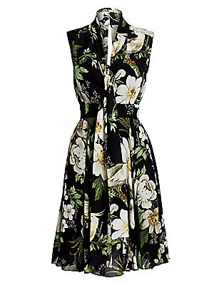 Image of A darkened backdrop works to better showcase the creamy petals of the flowers blooming across this dress. Scarf ties at the neckline are a romantic touch to the piece. V-neck with self-tie Sleeveless Concealed back zip closure Banded waist Lining: Silk Si