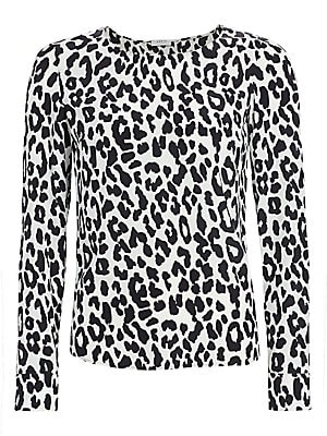 Image of A black-and-white leopard print adorns this silk top, with eye-catching results. Team with more prints plucked from the animal kingdom for a look with plenty of impact. Boatneck Long sleeves Barrel cuffs Back pleat High-low hem with side slits Silk Dry cl