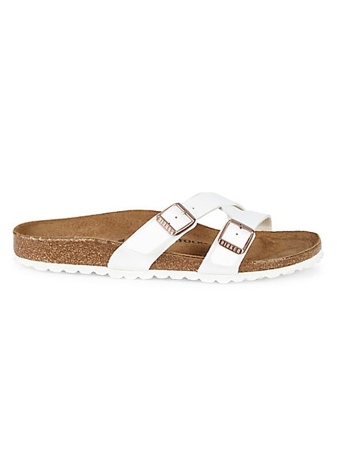 Stylish buckle strap slides feature Birkenstock\\\'s classic contoured cork footbed that supports the arches of your foot, and cradles your heel for all day comfort. Birko-Flor® synthetic leather upper Open toe Slip-on style Double buckle straps Suede lining Anatomically shaped cork-latex insole EVA sole Made in Germany. Women\\\'s Shoes - Contemporary Shoes > Saks Fifth Avenue > Barneys. Birkenstock. Color: White. Size: 40 (9).