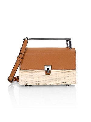Image of Convertible top handle bag in a woven natural straw construction with supple leather trim. Top handle Foldover flap with magnetic turn-lock closure Silvertone hardware Two interior card slots Metal feet Lined Straw/leather Imported SIZE Removable adjustab
