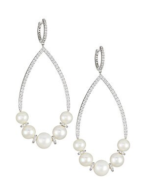 """Image of Dramatic dangling pearl and sparkling stone earrings with huggie styling. ONLY AT SAKS Pearl, 6-6.5mm, 7-7.5mm, 8-8.5mm Cubic zirconia Rhodium-plated sterling silver Hinged post back Imported SIZE Length, about 2.5"""" Width, about 1.25"""". Fashion Jewelry - A"""
