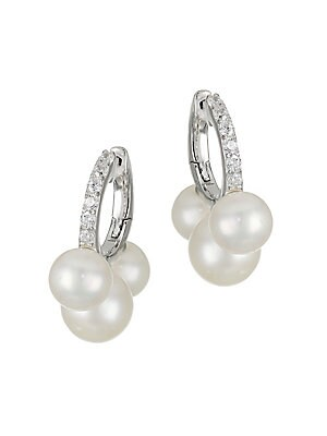 """Image of Delicate huggie-style hoop earrings embellished by a trio of lustrous white pearls. ONLY AT SAKS Freshwater pearl, 6-6.5mm, 7-7.5mm Cubic zirconia Rhodium-plated sterling silver Post back Imported SIZE Length, about 0.75"""" Width, about 0.25"""". Fashion Jewel"""