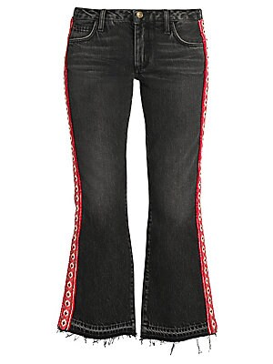 Image of Bohemian hand-embroidered trim accents the sides of these heavyweight jeans in a lived-in washed finish. Featuring a mid-rise cut, these jeans are cropped to the ankle with a distressed kick flare silhouette. Five-pocket style Zip fly with button closure