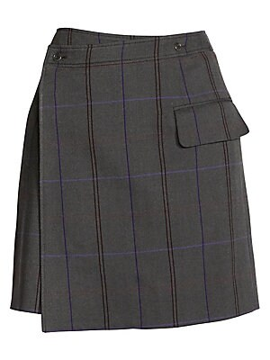 Image of A multicolored windowpane check patterns this A-line skirt, lending a power dressing edge to the piece. Its asymmetric wrap construction adds that kooky Acne touch. Banded waist Wrap-front with button closure Side flap pocket Asymmetric hem Lined Wool/cot