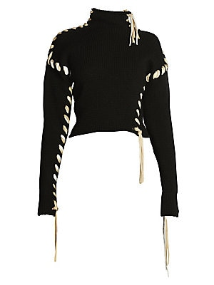 Image of An oversized looping blanket stitch trims this turtleneck sweater, injecting the piece with a handcrafted spirit. Its cropped silhouette enhances the femininity of the piece. Turtleneck Long sleeves Pullover style Dropped shoulders Wool Dry clean Made in