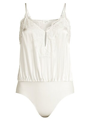 """Image of Alluring lace details this all-in-one bodysuit with a button and keyhole front and soft pleating for a blouson effect. V-neck Adjustable spaghetti straps Snap closure at gusset Silk Dry clean Imported SIZE & FIT About 29"""" from shoulder to gusset Model sho"""