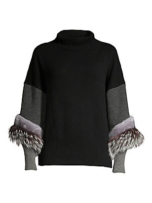 Image of Angled strips of fox and mink fur trim the sleeves of this luxurious cashmere sweater. A neutral color palette of grey and black is softened with the introduction of soft lilac in the fur. Turtleneck Pullover style Dropped shoulders Elongated ribbed cuffs