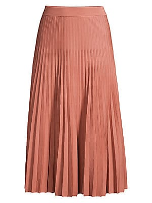 Image of Creative director Simon Holloway is recognized for his sophisticated color sensibility. To wit: a delicate blush tone is painted across this midi skirt, with a pleated finish underscoring its femininity. Banded waist Pull-on style Pleated finish Wool Dry