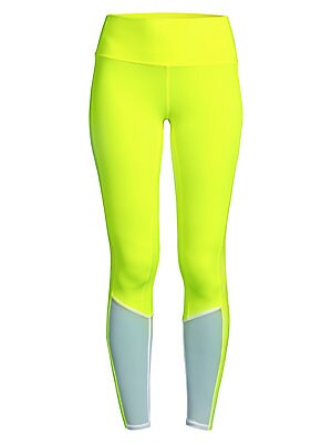 """Image of Bold two-tone leggings in a patchwork aesthetic features logo graphics at the sides. Banded waist Pull-on style Polyester/spandex/nylon Hand wash Imported SIZE & FIT Rise, about 9.5"""" Inseam, about 27"""" Leg opening, about 7"""" Model shown is 5'10"""" (177cm) wea"""
