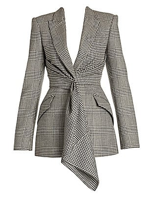 Image of A gathered and draped panel tumbles from the front of this blazer, softening the well-tailored silhouette. The wool fabrication is woven through with a Prince of Wales check for a highly English look. Peak lapels Long sleeves Buttoned cuffs Concealed fron