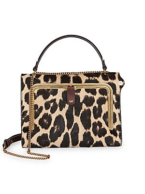 Image of Crafted in leopard print calf hair, this boxy little bag is an on-trend number. Top handle Removable, adjustable chain crossbody strap Side flap closure Goldtone hardware Exterior back slip pocket Interior credit card slots Calf hair Trim: Leather Made in