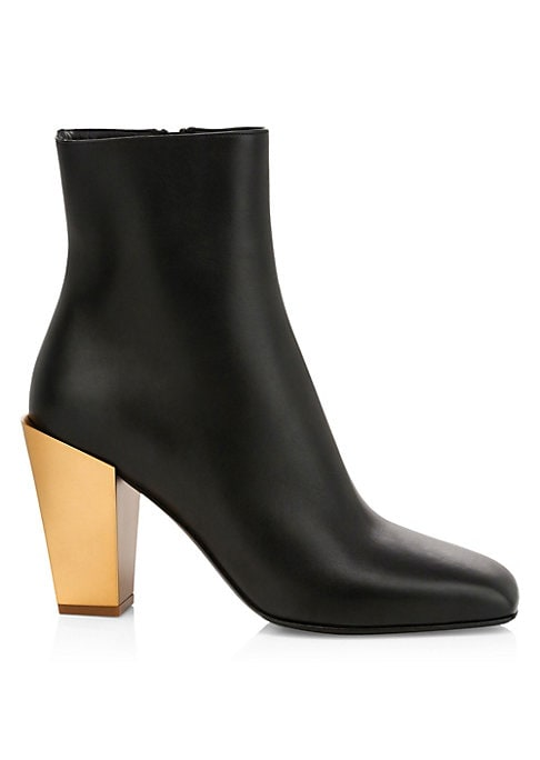Chic Italian ankle boots with a refined leather upper and a goldtone mirrored heel. Leather upper Almond toe Side zip closure Leather lining and sole Made in Italy SIZE Mirrored block heel. 3.25\