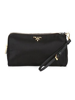 84c1cc0650971 Product image. QUICK VIEW. Prada. Tessuto Cosmetics Pouch.  360.00 · Saffiano  Leather French Wallet BLACK
