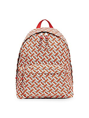 Image of A bold monogram print lends modernity to a compact backpack perfect for your essentials. Top handle Adjustable backpack straps Zip-around closure Silvertone hardware Two outside zip pockets One inside zip pocket Inside laptop compartment Quilted back pane