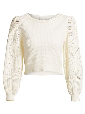 """Image of Crochet sleeves and puff shoulders lend this sweater an air of boho romance. Roundneck Three-quarter sleeves Pullover style Cotton Dry clean Imported SIZE & FIT Relaxed fit About 18"""" from shoulder to hem Model shown is 5'10"""" (177cm) wearing US size Small."""