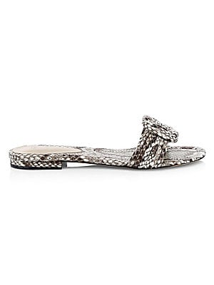 Image of A knotted strap is an elegant addition to these on-trend snakeskin slides. Python upper Open toe Slip-on style Python lining Leather sole Made in Brazil. Women's Shoes - Designer Classics > Saks Fifth Avenue. Alexandre Birman. Color: Natural. Size: 35 (5)