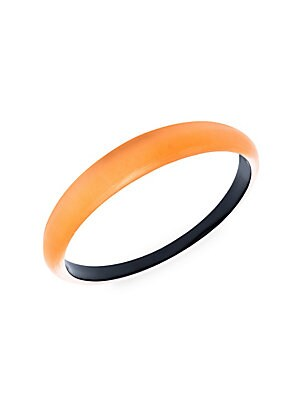 """Image of Add an easy color-pop with this tapered bracelet crafted from pure lucite. Orange lucite Slip-on style Made in USA SIZE Diameter, about 2.6"""" Width, about 0.5"""". Fashion Jewelry - Alexis Bittar > Saks Fifth Avenue. Alexis Bittar. Color: Orange."""