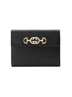 e7ac6d6d2d98 Gucci. GG Marmont Chain Wallet. $1550.00 · Zumi Leather Pouch BLACK. QUICK  VIEW. Product image