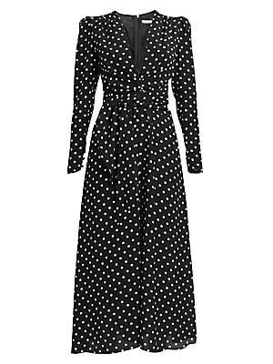 Image of From the Dressing For Pleasure Collection. Alessandra Rich loves to straddle the line between prim and provocative with her designs. This frock is one such piece; crafted in polka dot crepe de chine, its midi length is countered by a plunging neckline and