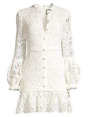 Image of A lovely lace finish and structured puff sleeves add romantic elegance to this tailored mini. Roundneck Long puff sleeves Concealed back zip Button front trim Ruffle hem Stretch lining Cotton/nylon Dry clean Imported SIZE & FIT Fit-and-flare silhouette Ab
