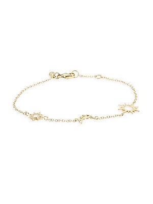 "Image of Delicate and feminine, this celestial-inspired gold cable chain links together a micro starburst, a moon crescent and a sun station. White topaz 14K yellow gold Lobster clasp Handmade in Canada SIZE Adjustable length, about 7"" with 3"" extender. Fashion Je"