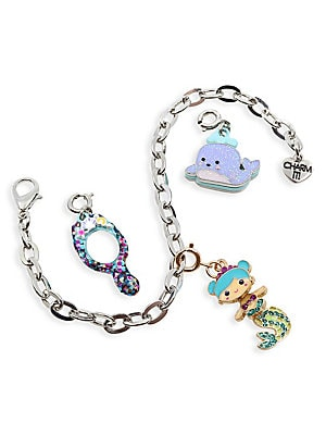 Image of Start her Charm It! collection with an under the sea gift set perfect for little mermaids. Set includes a Gold Mermaid Swivel charm, Mermaid Mirror charm, Glitter Whale charm, silvertone bracelet and signature gift box. All charms feature clasps to easily