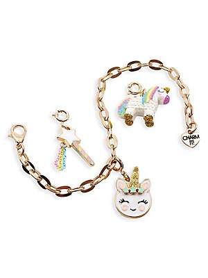 Image of Start her Charm It! collection with a magical unicorn gift set perfect for little believers. Set includes a Unicorn Piñata charm, Magical Wand charm, Unicorn Smiley Charm, goldtone bracelet and signature gift box. All charms feature clasps to easily move