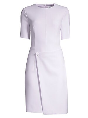 """Image of A classic dress made modern with faux-wrap styling and sophisticated metal snap hardware. Roundneck Short sleeves Back zip Lined Polyester/viscose/cotton/elastane Dry clean Made in USA SIZE & FIT About 38"""" from shoulder to hem Model shown is 5'10 (177cm)"""