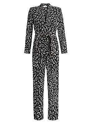 "Image of Eighties-inspired jumpsuit complete with a strong padded shoulder and a sexy leopard print. Deep v-neck Long sleeves Self tie waist Padded shoulder Straight leg Lining: Viscose/elastane Shell: silk Dry clean Imported SIZE & FIT About 53"" from shoulder to"