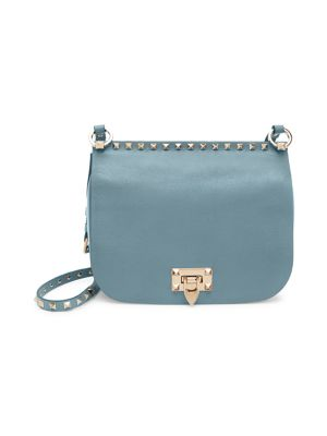Valentino Garavani Rockstud Leather Saddle Bag In English Green
