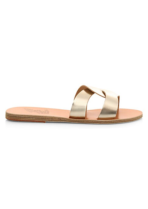 Minimal flat leather sandals elevated with a luxe metallic finish. Leather upper Open toe Slip-on style Leather/rubber sole Imported. Women\'s Shoes - Workshop Shoes > Saks Fifth Avenue > Barneys. Ancient Greek Sandals. Color: Platinum. Size: 39 (9).