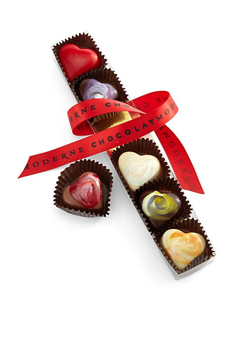 Image of An elegant clear sleeve of six jewel-like airbrushed and hand-painted hearts. Includes 6 chocolate hearts.1 each: Sea Salted Caramel, Toasted Coconut Ganache, Dark Ganache with Tuthilltown Baby Bourbon, 72% Venezuelan Dark Ganache, Passion Fruit Cardamom