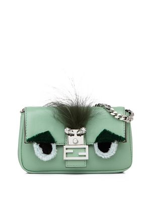 Image of Fendi's classic Baguette silhouette is reimagined in a petite pouch design with soft fur and crystal appliques that form the brand's charming Buggie face. Clips to your handbag for added character and provides extra storage for small essentials. Chain str