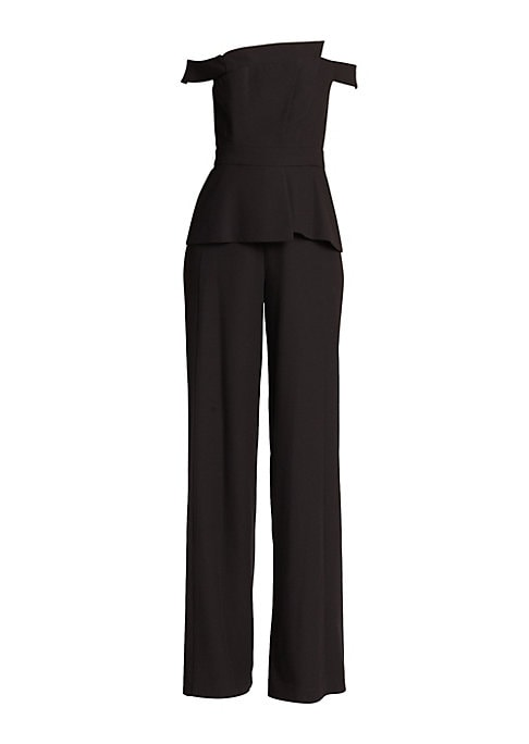 "Image of Asymmetrical jumpsuit in wide-leg silhouette. Off-the-shoulder neckline. Short sleeves. Concealed back zip. Structured bodice. Peplum waist. Polyester/rayon/spandex. Dry clean. Made in USA of imported fabric. SIZE & FIT. Inseam, about 36"".About 55"" from s"