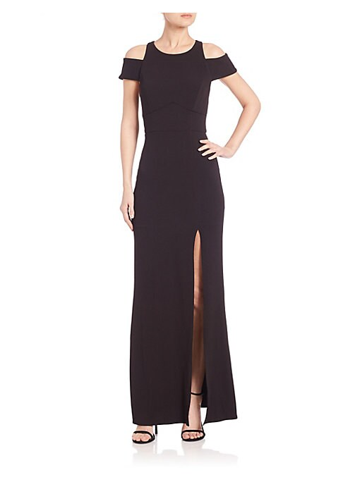 "Image of Exquisite gown with angular details and cut-outs. Roundneck. Cut-out shoulders. Cap sleeves. Exposed back zip. Bust darts. Seamed waist. Off-center front slit. Lined. About 60"" from shoulder to hem. Polyester/spandex. Machine wash. Made in USA. Model show"