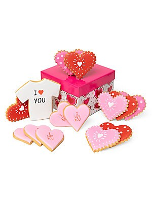 "Image of An assortment of baked goods bearing a thoughtful message is packed in a decorative gift box tied with a matching grosgrain ribbon. Includes: 1 I ""heart"" you tee, 4 graffiti hearts, 4 polka dot hearts, 5 pink I luv you hearts Made in USA SPECIFICATIONS Sh"