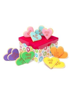 "Image of Conversation heart cookies packed in a decorative set up box tied with a matching grosgrain ribbon. Includes 8 conversation heart cookies.6""W X 6""H X 4""D.12 oz. Shelf life: 8 weeks. Made in USA. SPECIAL PROCESSING & DELIVERY. This item ships directly from"