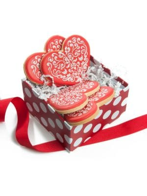 "Image of Wonderfully intricate lace heart cookies are packed in a decorative set up box tied with a matching grosgrain ribbon. Includes: 4 cookies.5""W X 5""H X 3""D.10 oz. Shelf life: 8 weeks. Made in USA. SPECIAL PROCESSING & DELIVERY. This item ships directly from"