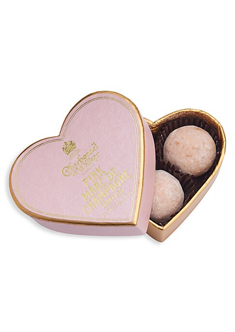 Image of A white chocolate truffle with a hint of strawberry and milk chocolate Marc de Champagne centre. Includes 3 pieces.1 oz. Shelf life: 182 days. Made in UK.