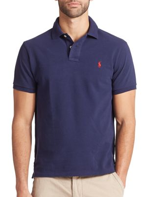 Image of This iconic trim-fitting polo is crafted from durable, breathable cotton mesh and finished with Ralph Lauren's signature pony embroidery. .Spread collar. Two-button placket. Short sleeves. Uneven vented hem. Cotton. Machine wash. Imported.