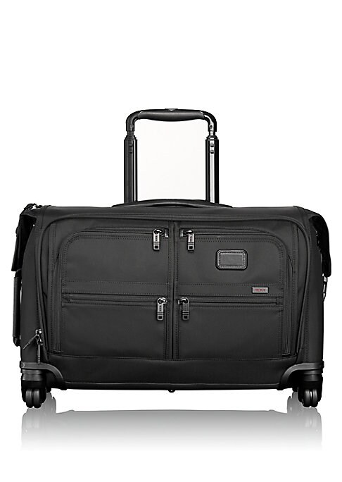 Image of This four-wheeled, carry-on garment bag is easy to handle, even down a narrow airplane aisle. In addition to carrying a suit or other hanging garments, it features plenty of interior pockets for accessories. Top handle. Zip closure. Side handles. Exterior