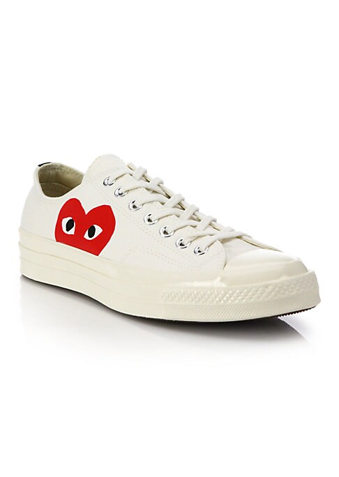 Image of A laidback, low-profile canvas sneaker features the iconic heart design peering out at its side. .Canvas upper. Rubber cap toe. Rubber sole. Padded insole. Imported.