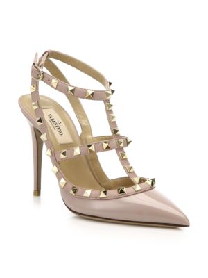 """Image of Signature metal studs trim this point toe slingback, expertly crafted in Italy of rich patent and smooth leather. .Self-covered heel, 4.25"""" (110mm).Patent and leather upper with metal studs. Point toe. Adjustable leather strap. Leather lining and sole. Pa"""
