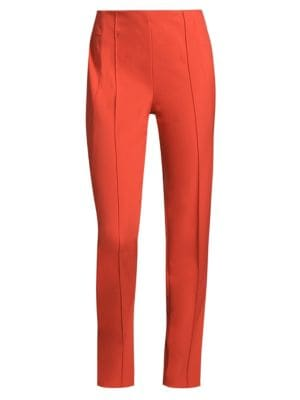 """Image of Tailored trousers with leg-lengthening pintucks. Flat front. Concealed side zip. Front-and-back pintucks. Tapered silhouette. Rise, about 11"""".Inseam, about 29"""".Leg opening, about 6"""".Nylon/elastane. Machine wash. Imported of Italian fabric."""