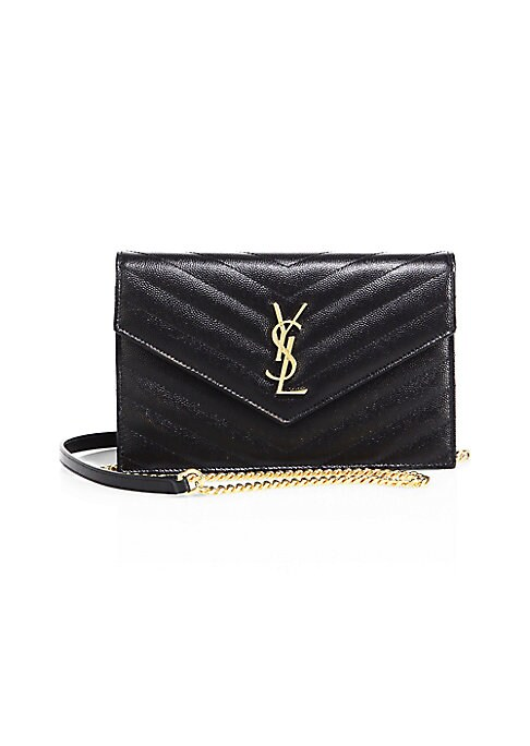Image of The organized design of a wallet is beautifully reimagined in handbag form, its matelasse body crafted of grained leather and finished with the YSL insignia in the spirit of the brand's heritage. Carry with or without its chain strap for day-to-evening ve